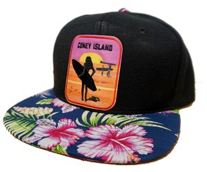Coney Island hat, tropical brim with a surfer girl design on a flat bill cap, hand-printed with a hand applied patch, handmade gifts for everyone made in Brooklyn NY