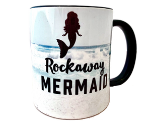Rockaway Beach mug, Rockaway mermaid friends with a mermaid design on an ocean wave backdrop with black handle and interior, handmade mug, handmade gifts made in Brooklyn NY
