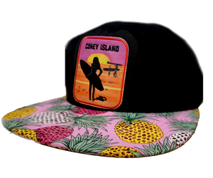 Coney Island hat, pineapple brim with a surfer girl design on a flat bill cap, hand-printed with a hand applied patch, handmade gifts made for everyone in Brooklyn NY