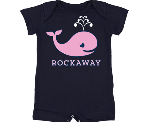 An adorable Rockaway romper. A pink whale design on a navy blue baby Romper. Handmade gifts for babies made in Brooklyn New York.