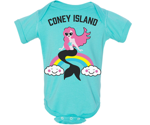 Totally cool Coney Island baby girl onesie with a rainbow mermaid design on an aqua background. Handmade gifts for babies and parents to be made in Brooklyn New York. Perfect for a baby shower gift.
