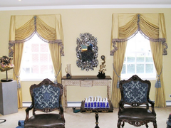 Traditional classic interior design living room family rich colors ornate designs window treatments fabrics south florida