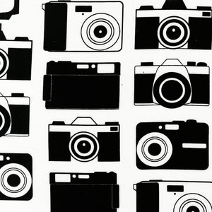 "ROBERT KAUFMAN ""BOY TOYS"" CAMERAS Black by 1/2 yard"