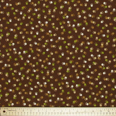 "ROBERT KAUFMAN ""WHISKERS & TAILS"" PAWS Brown by 1/2 yard"