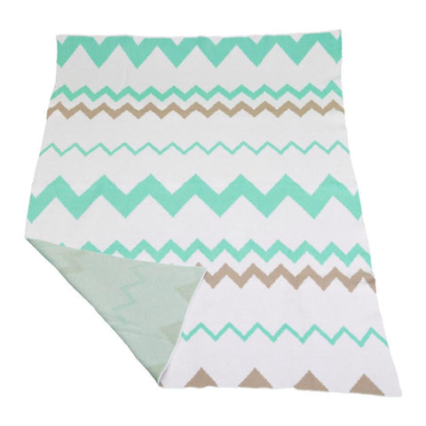 Little Bonbon vibrant green zigzag cot blanket