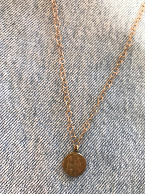Gold medal pendant necklace