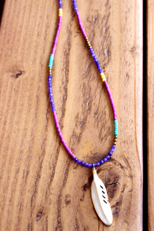 multi colored gemstones with bone feather pendant