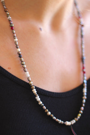 multi colored pearls with red chrystal slivered moon.