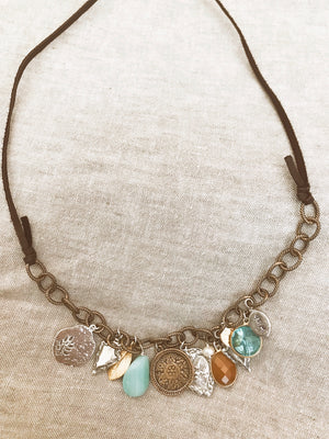 charm necklace on bolero style leather