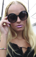"alt=""audrey-round-sunglasses-in-black-front"""