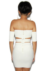 "alt=""off-the-shoulder-cut-out-bandage-dress-in-off-white-back"""