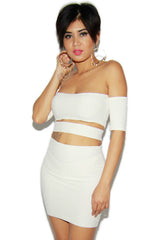 "alt=""off-the-shoulder-cut-out-bandage-dress-in-off-white-front"""