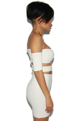 "alt=""off-the-shoulder-cut-out-bandage-dress-in-off-white-side"""