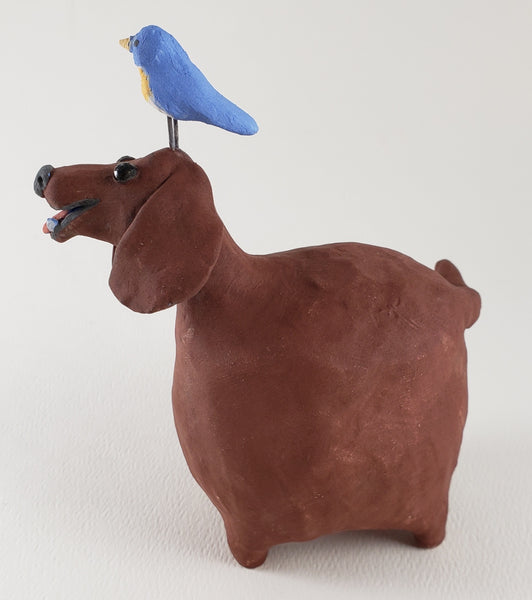 Barbara the Brown Lab and her bluebird friend