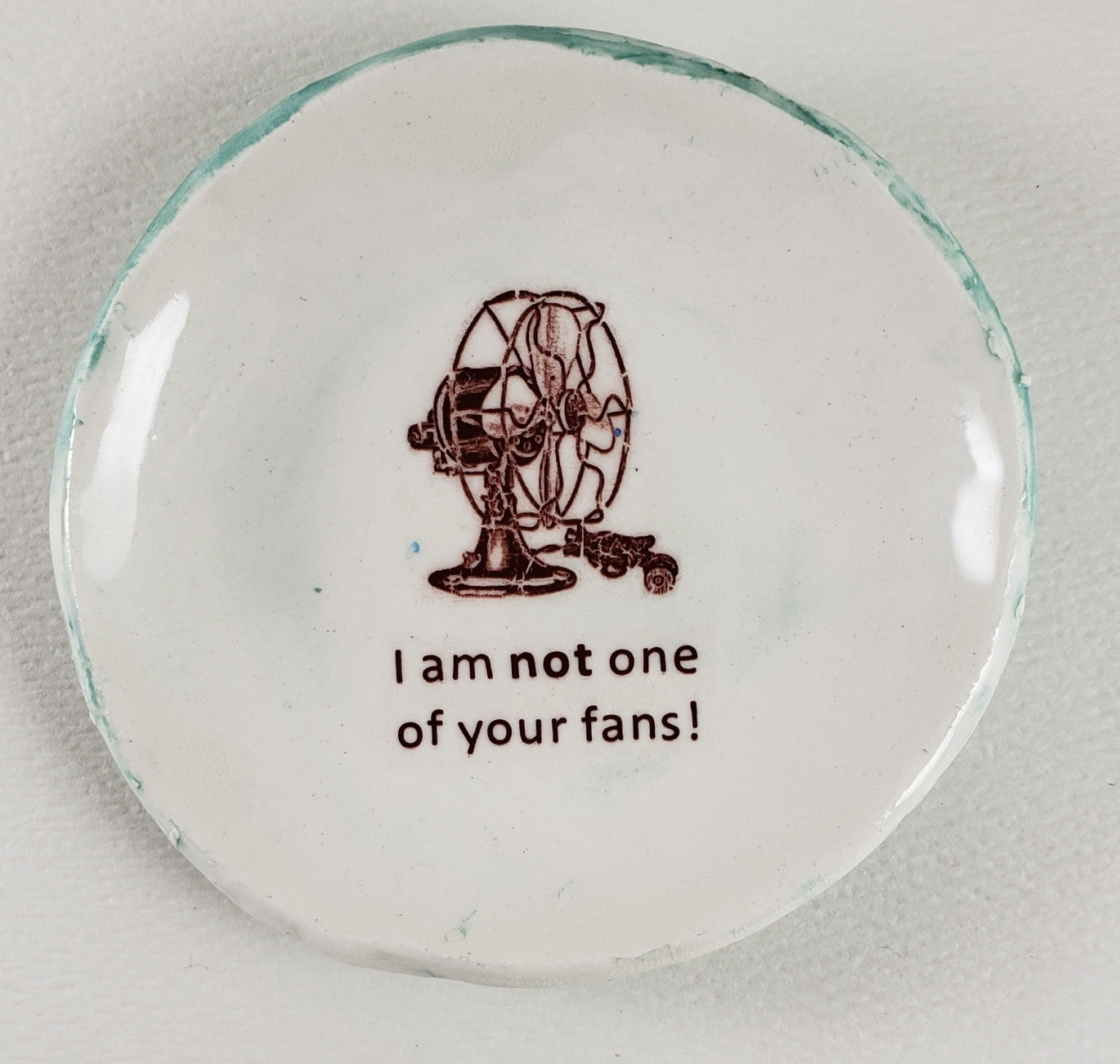 "Tiny Plate with ""I am not one of your fans!"""