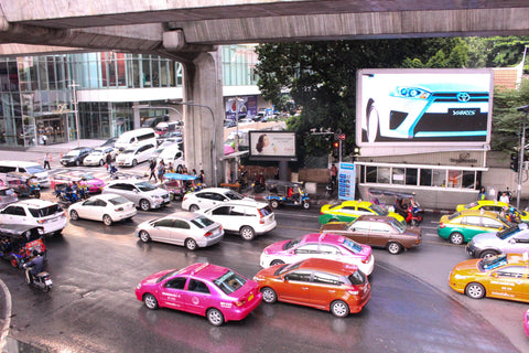 Bangkok traffic and their signature hot pink cabs.