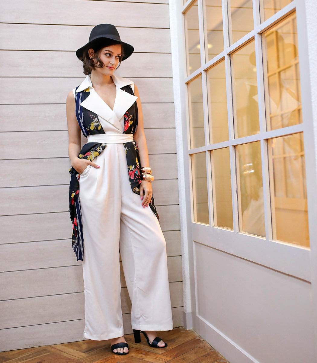 4d91d92a1f57 Soften the utilitarian Milnerton jumpsuit by layering it with a floral  scarf vest. Glam it up with heels