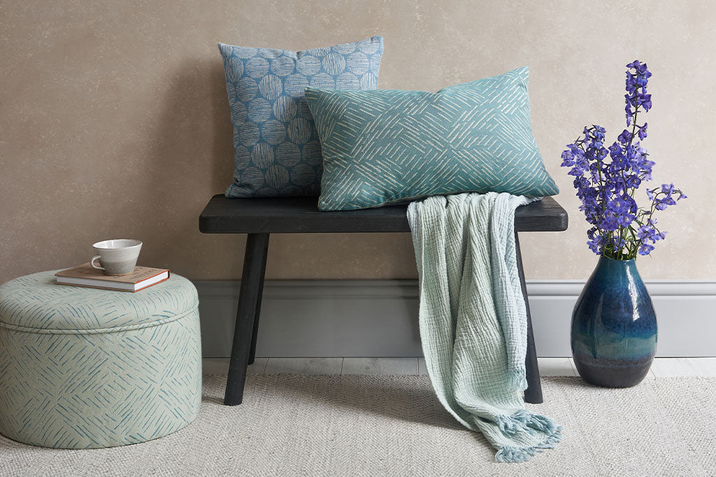 Claire Gaudion new cushions throws and footstools in living room