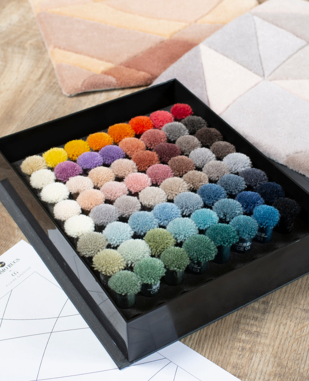 Claire Gaudion by Momo Rugs 64 Colour custom rug pom box