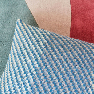 Claire Gaudion Inlet Cashmere Cushion - Woven Teal Cushion mixed with grey and cream. Close up photo