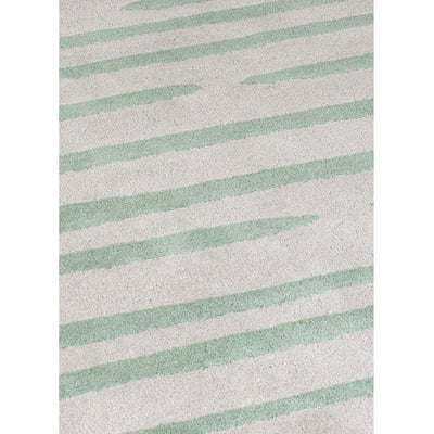 Island Leaf Rug is an abstract lines patterned rug in two colours, cream and green. The abstract lines pattern creates a circle design within this rectangular wool rug. Rug pile close up.