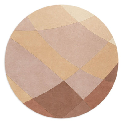 Rhythmic Tides Sand Round Rug is designed in warm earthy terracotta and pink colours and features a curved pattern to depict the ebb and flow of the tides.