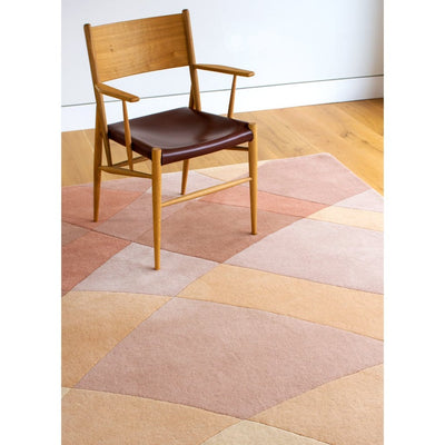 Rhythmic Tides Sand Rug is an earthy-toned terracotta modern rug that takes inspiration from the ebb and flow of the tides. This modern wool rug has a palette of warm terracotta reds and russet tones, through to pink and apricot pastels and creamy neutral shades.