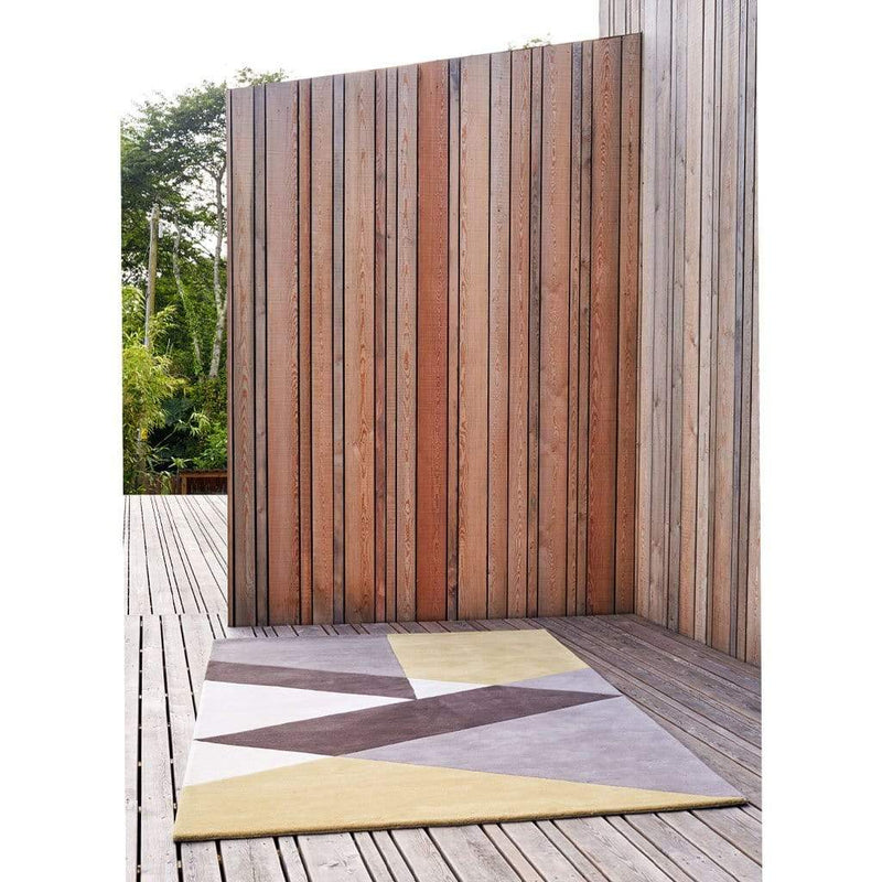 Sark Coupee Taupe Rug is a modern colour block rug with a bold geometric pattern in cream, grey, brown and gold. Handmade with high quality New Zealand wool.