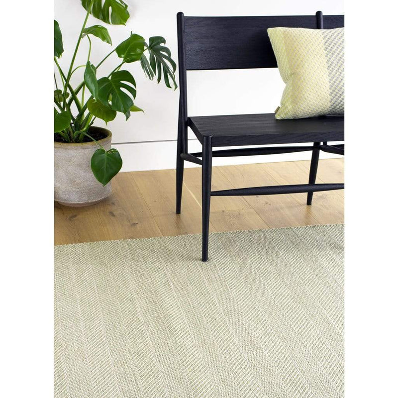 Tibba Fern Rug is a green recycled plastic bottle rug handwoven from 100% repurposed. The herringbone style weave is suited to modern and traditional homes.