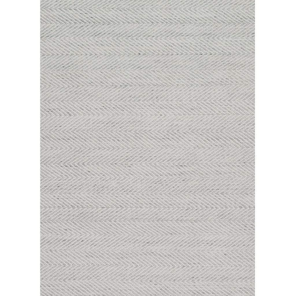 Tibba Sand Rug is a natural coloured recycled rug handwoven from 100% repurposed plastic bottles. Herringbone-style rug that looks and feels just like wool. Product close up.
