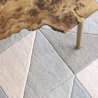 Tielles Neutral Rug is a modern geometric rug which features a gentle and relaxing mix of soft greys, taupes and warm natural shades. Rug detail showing the cut wool pile.