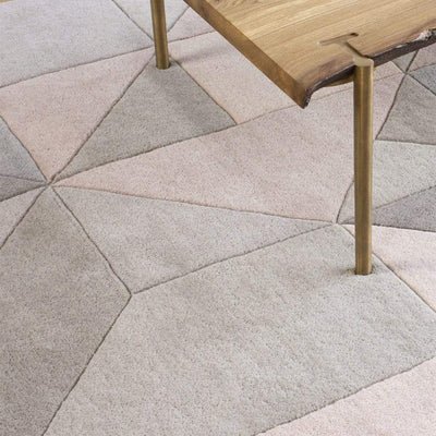 Tielles Neutral Rug is a modern geometric rug which features a gentle and relaxing mix of soft greys, taupes and warm natural shades. Product close-up.