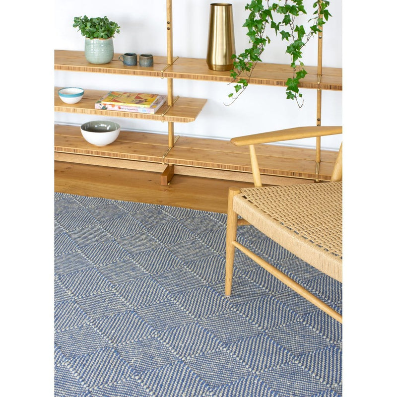 Zala Denim Rug - a blue recycled rug, handloom woven from 100% recycled plastic bottles. Our sustainable rugs are helping to combat plastic waste by using hundreds of recycled plastic bottles for each rug. Rug weave close-up.