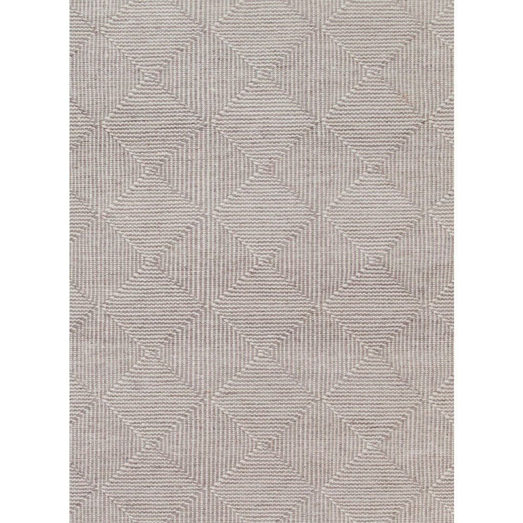 Zala Natural Rug is a recycled rug handwoven from 100% repurposed plastic bottles. The recycled yarns feel just like wool. This beautifully soft textured rug features a diamond weave pattern in natural undyed yarns. Image shows a close up of the weave design.