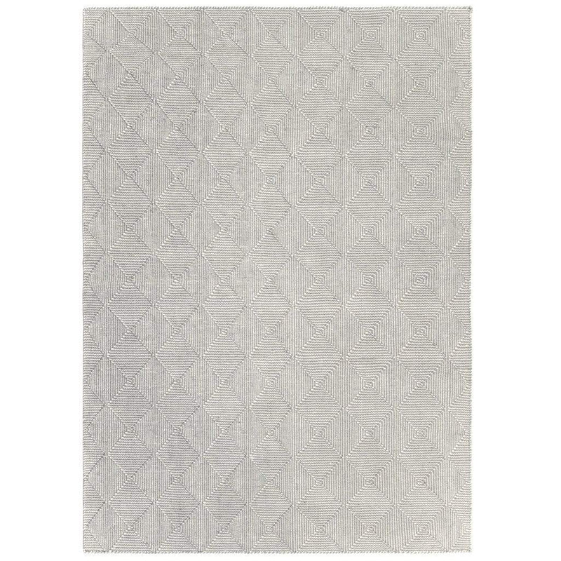 Zala Slate Rug is a recycled rug handwoven from 100% repurposed plastic bottles.  This recycled flat weave rug features a diamond weave pattern in pale grey and neutral yarns. Close up of weave shown.