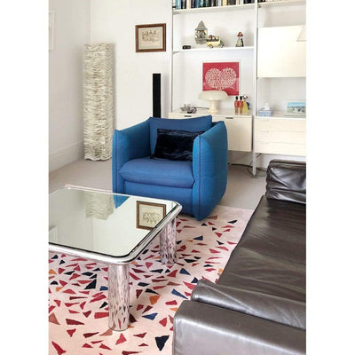 Lifestyle living room image of Albecq Rug - a patterned modern rug with a colourful palette of reds, oranges and blues on a pink beige background.