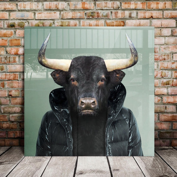 Fernando the Spanish Bull, from the Zoo Portraits art series created by Yago Partal, mounted on aluminium, covered in plexiglass and resting against a brick wall on a wooden floor.
