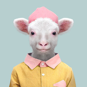 An image of a sheep dressed in a yellow and pink blouse, with a yellow hat, gazing straight ahead. This artwork is from the Zoo Portraits series created by Spanish artist Yago Partal.