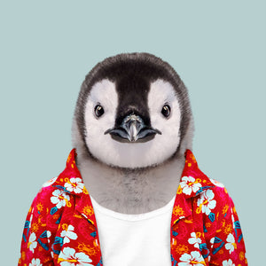 An image of an emperor penguin, wearing a white T-shirt and a red Hawaiian style shirt, gazing straight at the camera.  This artwork is part of the Zoo Portraits art series, created by Spanish artist Yago Partal.
