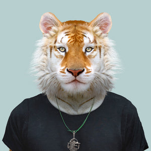 An artwork of a golden tiger dressed in a black T-shirt, looking straight at the viewer. This work is part of the Zoo Portraits animal art series created by Spanish artist Yago Partal.