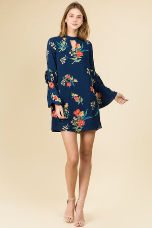 FLARED TIE SLEEVE MOCK NECK DRESS IN NAVY FLORAL