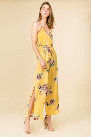V- NECK YELLOW FLORAL JUMPSUIT WITH SIDE SLITS AND ADJUSTABLE STRAPS