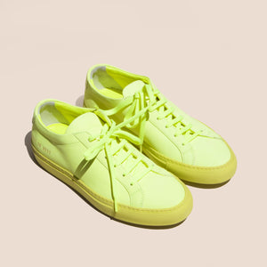 Original Achilles Low Fluo in Neon Yellow, angled view, available at LCD.