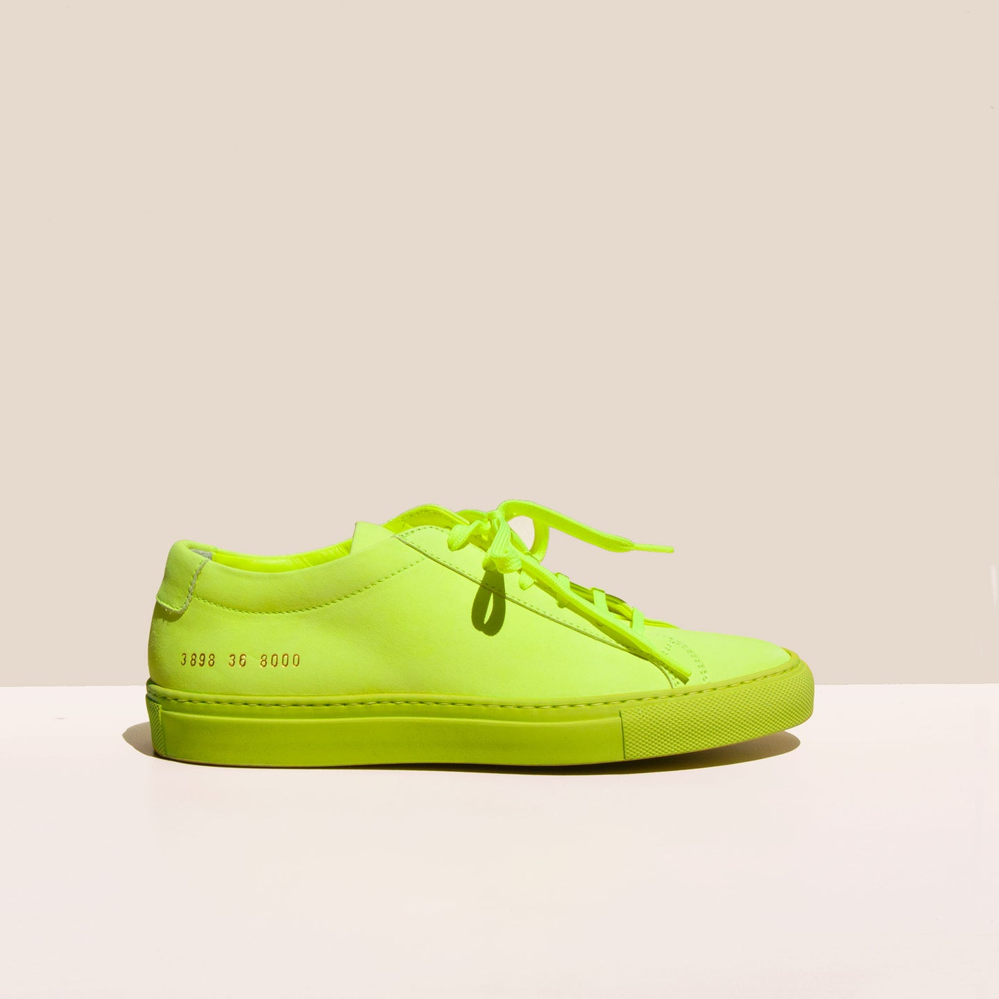 Original Achilles Low Fluo in Neon Yellow, side view, available at LCD.