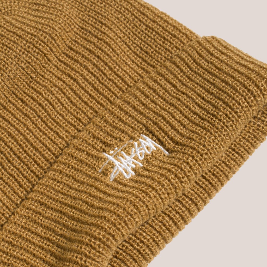 Stussy - Basic Cuff Beanie in Camel, view of logo detail.