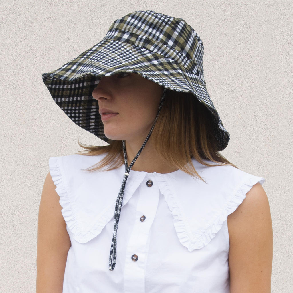 Ganni - Bucket Hat with Tie - Kalamata Check, angled view, available at LCD.