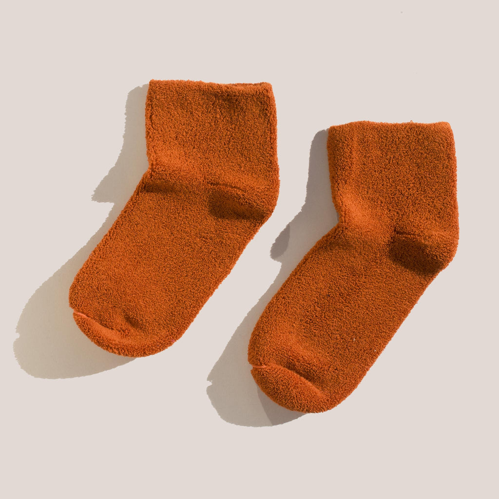 Baserange - Buckle Ankle Socks in Murcott Orange, pictured as a pair.