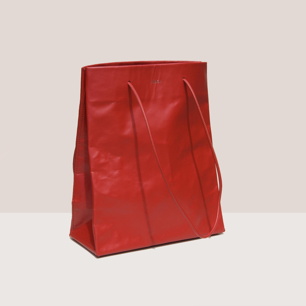 Medea - Tall Busted Bag - Red, angled view, available at LCD.