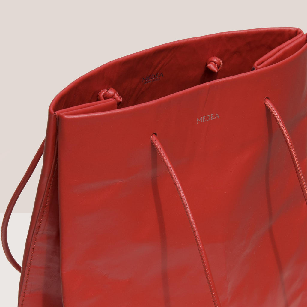 Medea - Tall Busted Bag - Red, logo detail, available at LCD.