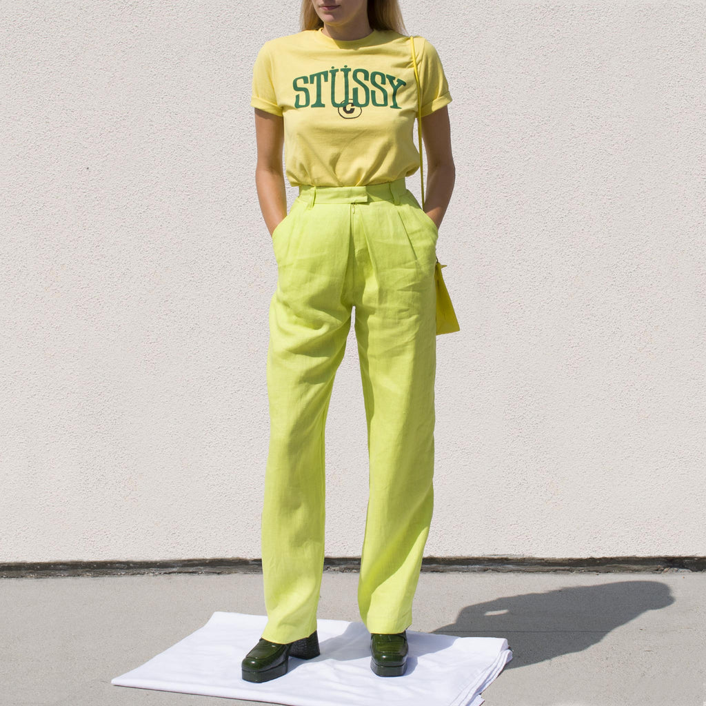 Stussy - Copyright Tee in Lemon, front view.